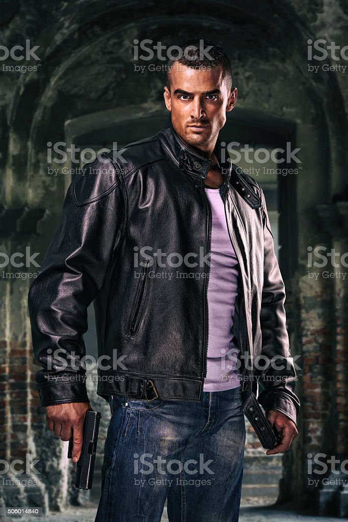 Handsome , Dangerous looking Man With A Gun in his hand