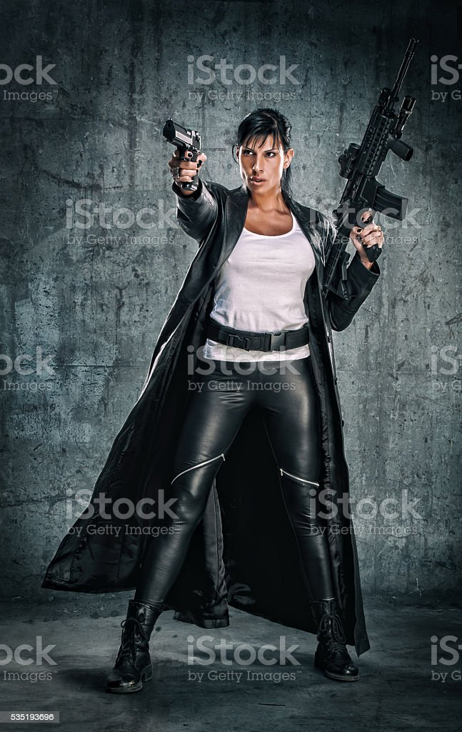 Women as Movie Action Here with a gun and machine gun in here hands
