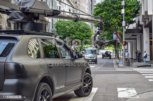 istock Action Movie Shooting in Downtown Los Angeles with Camera Car 1133665609