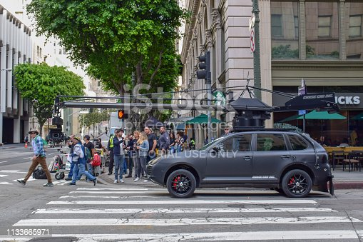 istock Action Movie Shooting in Downtown Los Angeles with Camera Car 1133665971