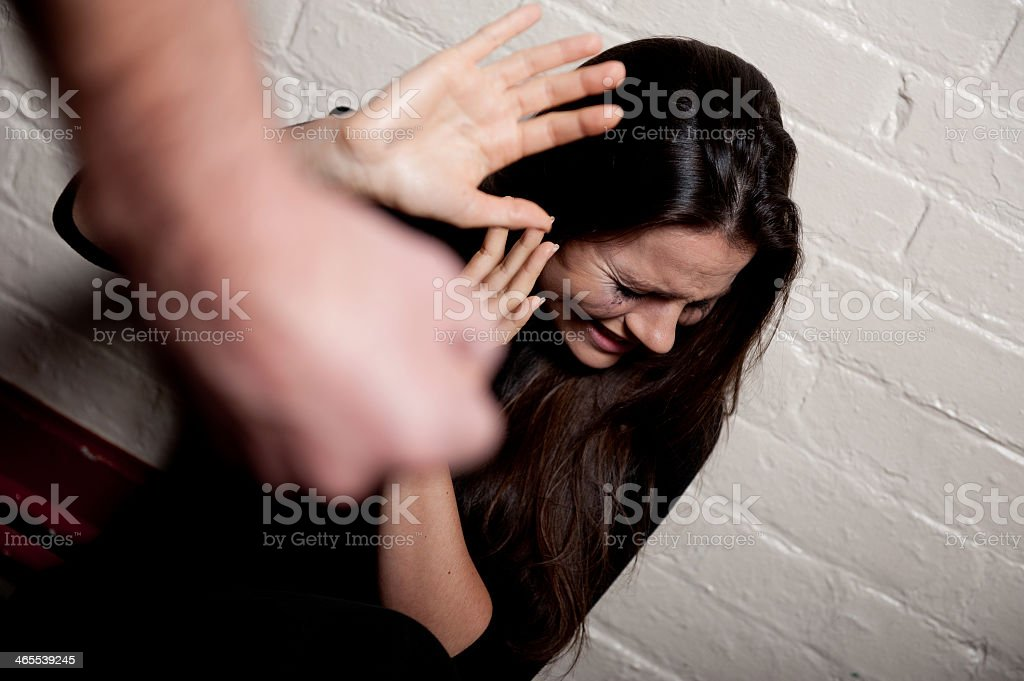 Action photo of woman being harassed by domestic partner stock photo