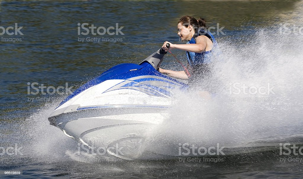 Action Photo of Young Woman on Seadoo Watercraft with Water-Spray royalty-free stock photo