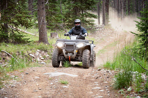ATV Action atv action / riding around having fun / motion blur on wheels quadbike stock pictures, royalty-free photos & images