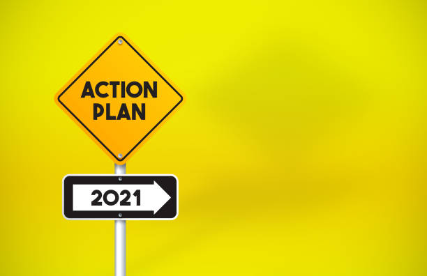 Action Plan 2021 Directional Road Sign On Yellow Background stock photo