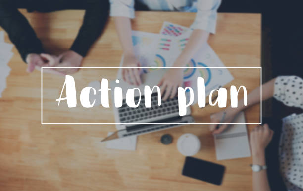 Action Plan message on the device works the table background correspondence Customer Support Concept stock photo