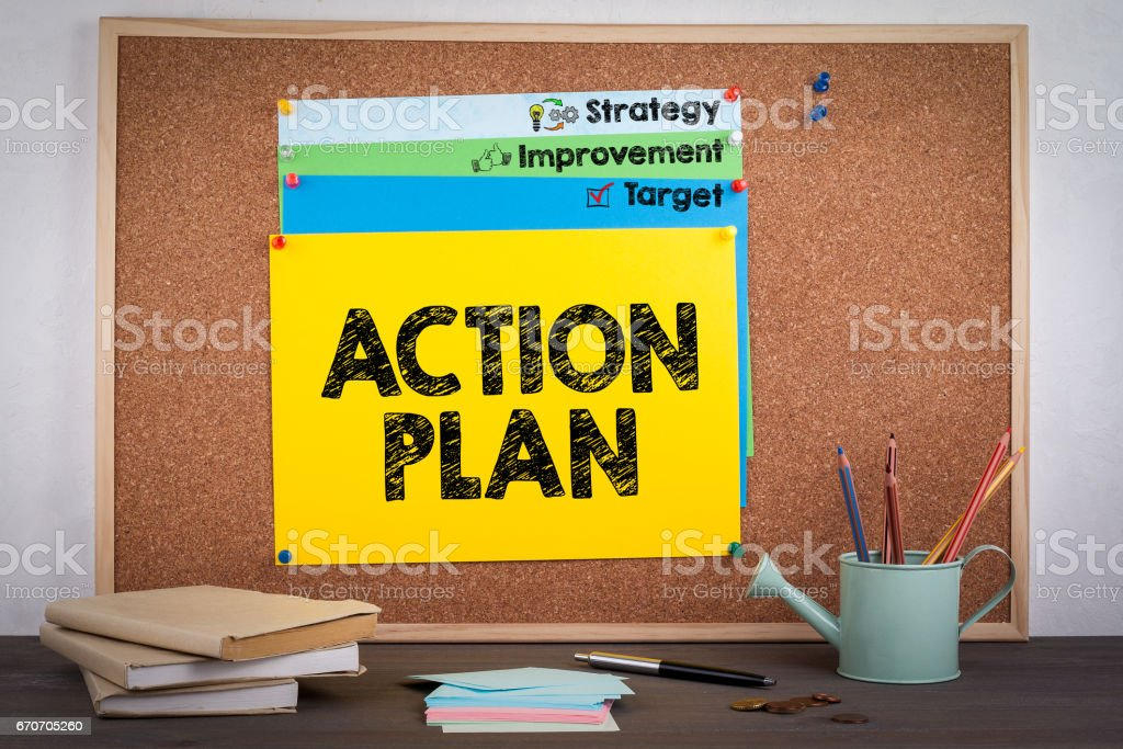 Action Plan. Note on board on the desk with books stock photo