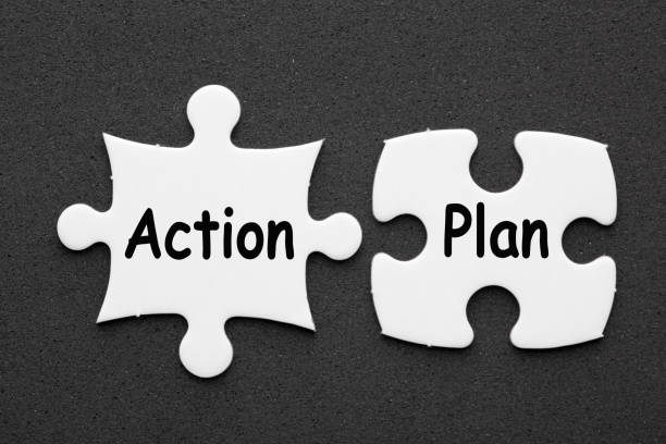 Action Plan on two puzzle stock photo