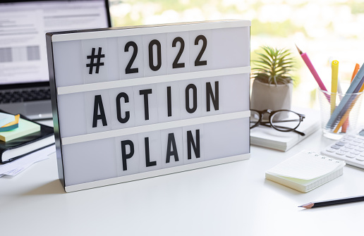 2022 action plan text on light box on desk table in office.Business motivation or management.