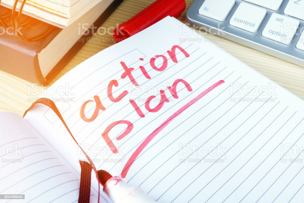 Action plan written in a note. stock photo