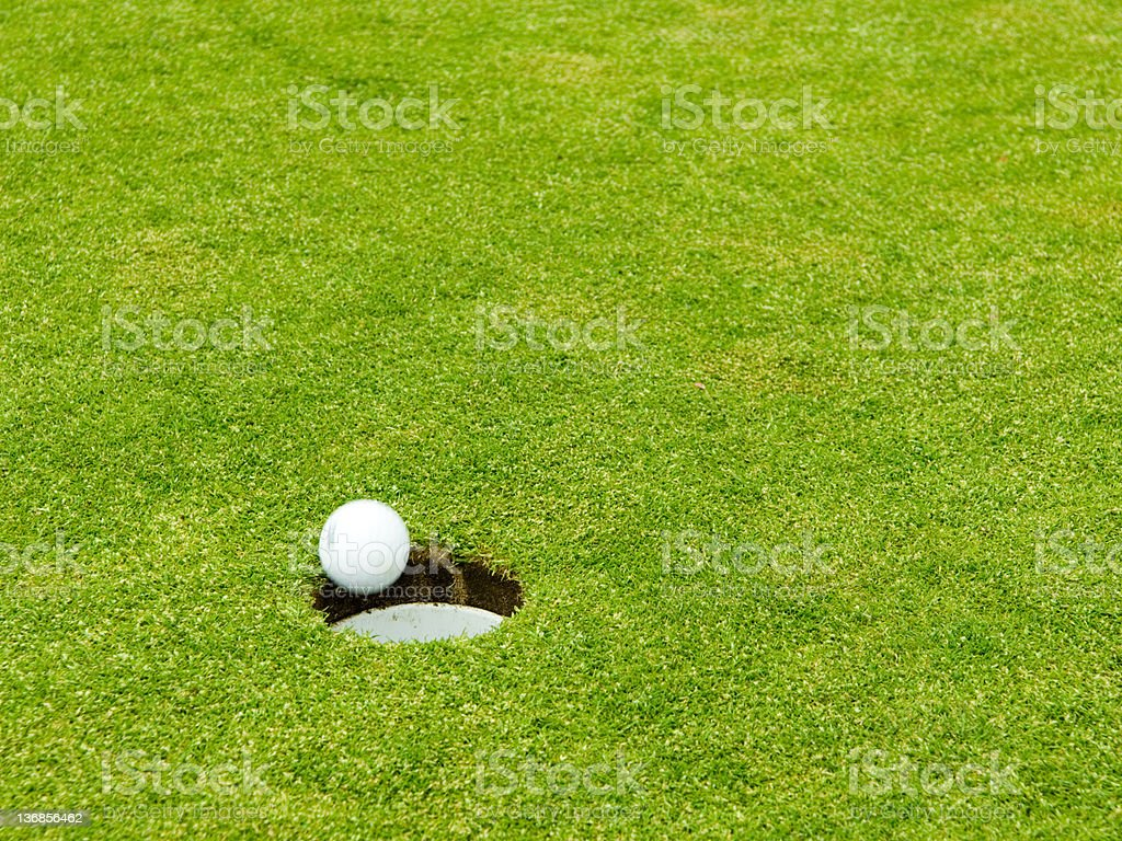 Action Putt Sinking in Cup stock photo