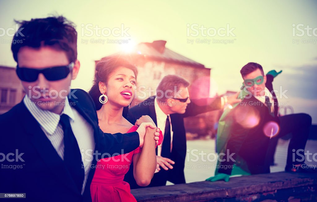 Action Scene of Business People Saving Woman Concept stock photo