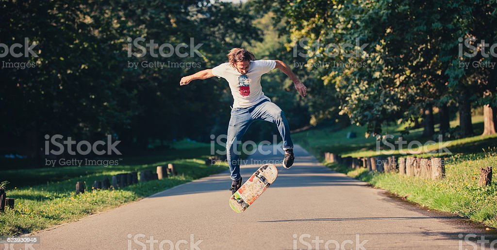 Action shot of a skateboarder skating, doing tricks and jumping stock photo