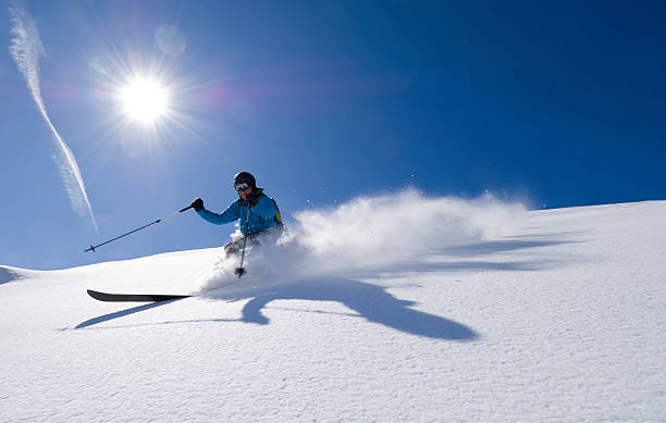 Action shot of an alpine skier stock photo