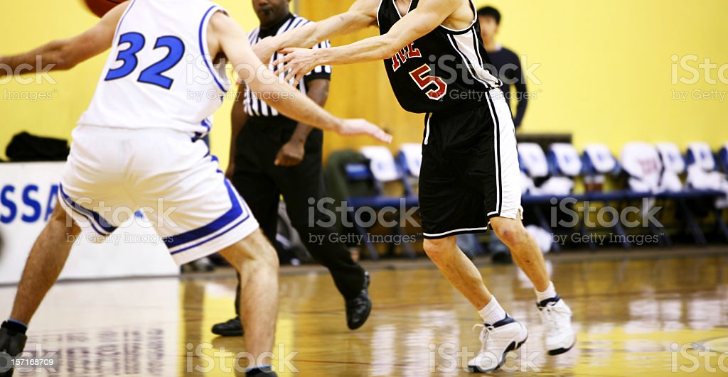 Action shot of players in a basketball game royalty-free stock photo