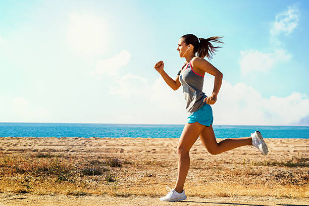 action shot of running girl. - jogging stock pictures, royalty-free photos & images