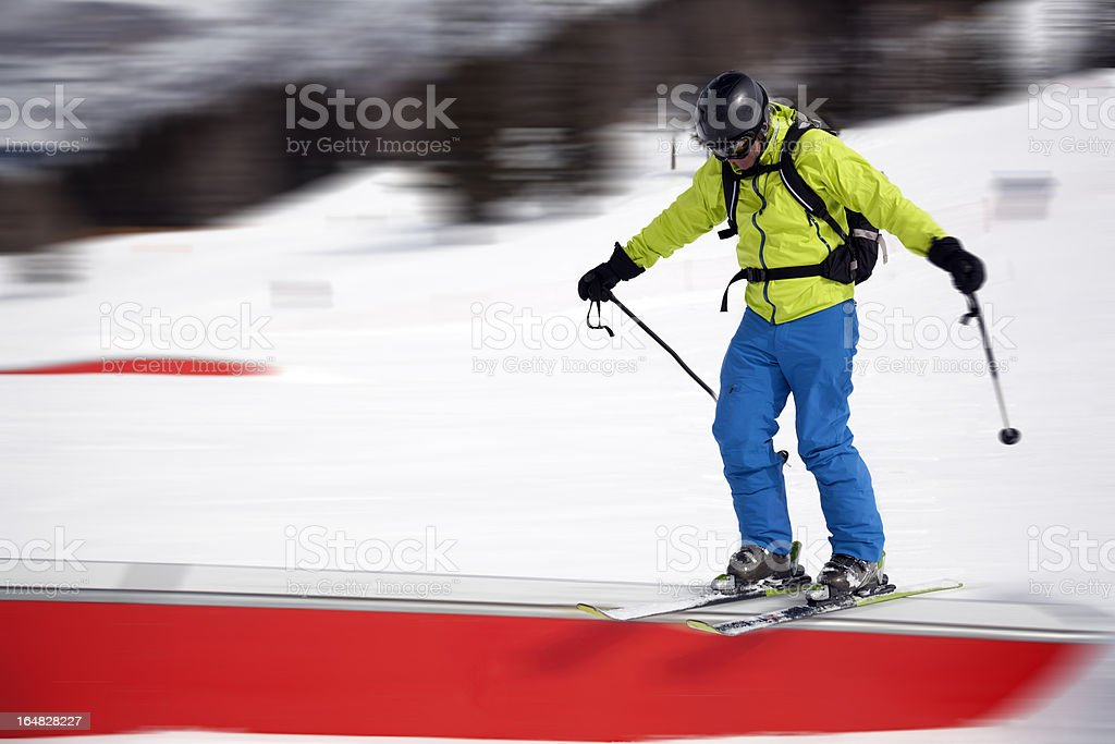 Action shot of skier doing rail in a Snowpark royalty-free stock photo