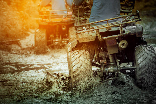 action shot of sport atv vehicle running in mud track - bike tire tracks foto e immagini stock