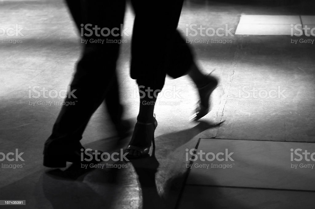 Action shot of the feet of a man and woman dancing royalty-free stock photo