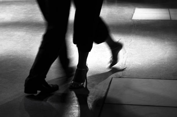 Action shot of the feet of a man and woman dancing stock photo
