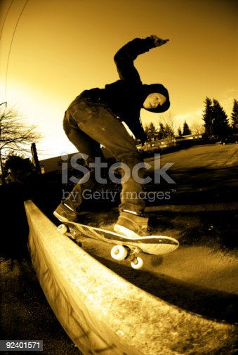 istock Action Sports - Backside 5-0 on Jersey Barrier 92401571