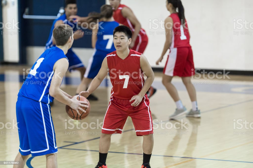 Action-Packed Co-ed High School Basketball Game stock photo
