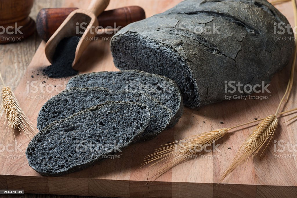 Activated carbon bread - pane carbone vegetale stock photo