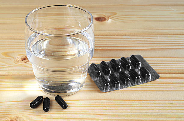 Activated charcoal and water stock photo