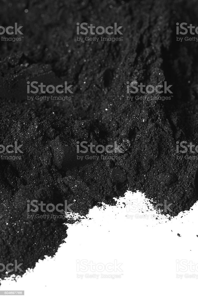 Activated charcoal powder stock photo