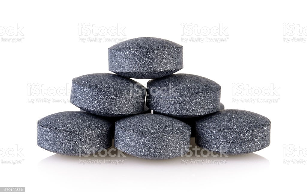 activated coal tablets stock photo