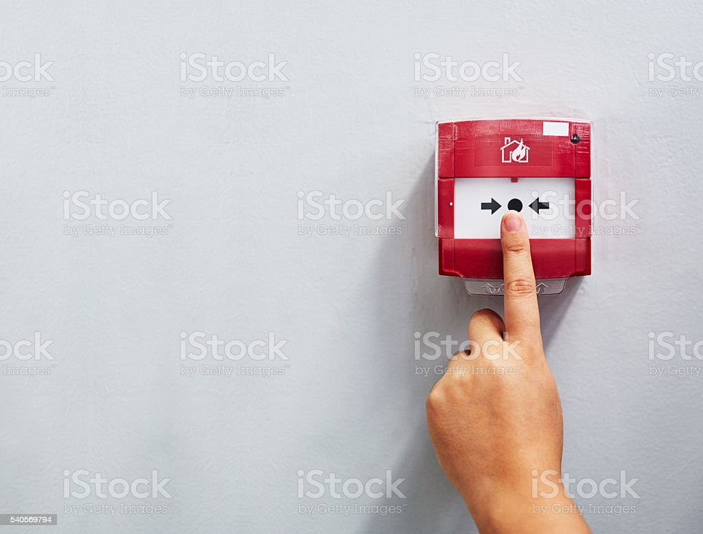 Activating the alarm stock photo