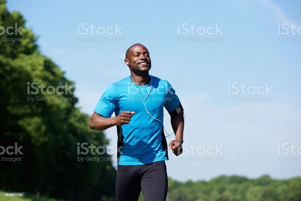 Active african american man running stock photo