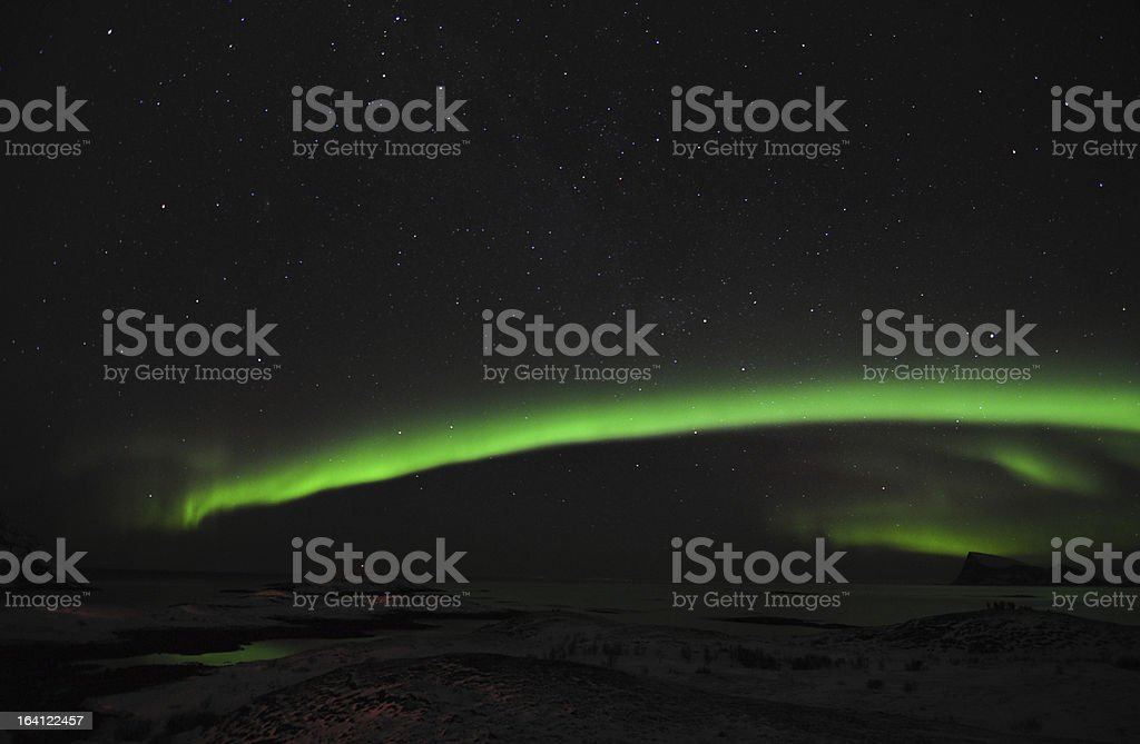 Active aurora borealis and a group of photographers royalty-free stock photo