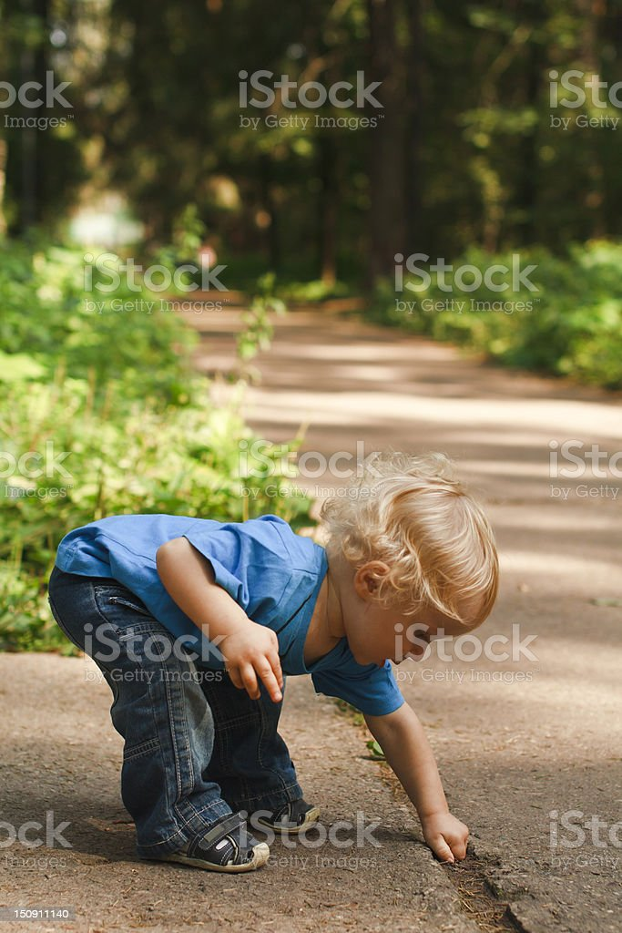 Active baby learning in nature royalty-free stock photo