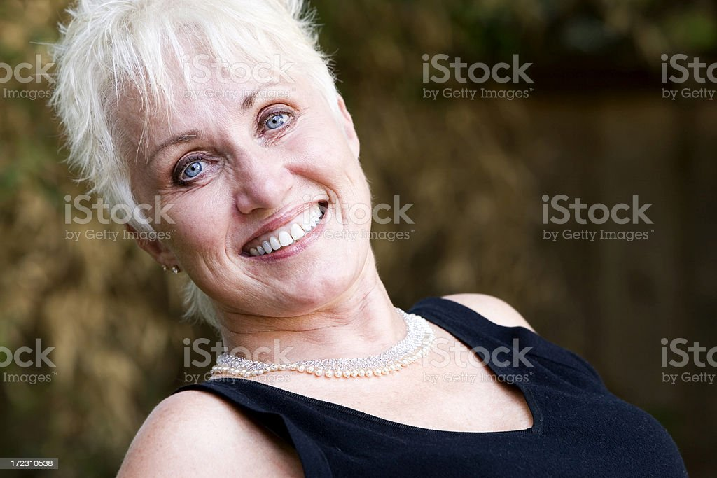 Active Beautiful Blond Senior Woman Portrait, Copy Space royalty-free stock photo