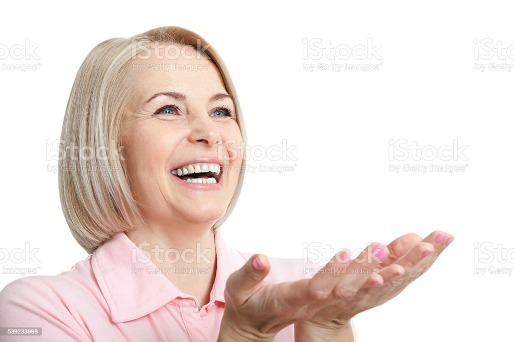 Active beautiful middle-aged woman smiling friendly and looking royalty-free stock photo