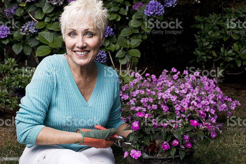 Active Beautiful Senior Woman Gardening, Copy Space royalty-free stock photo