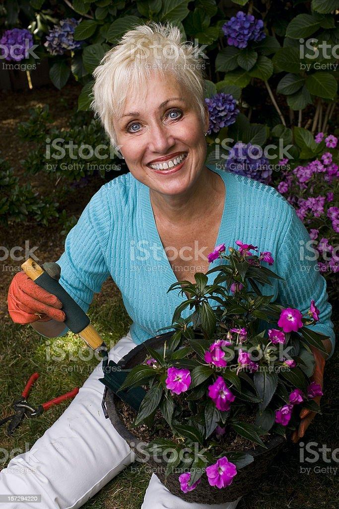 Active Beautiful Senior Woman Gardening, Smiling at Camera royalty-free stock photo