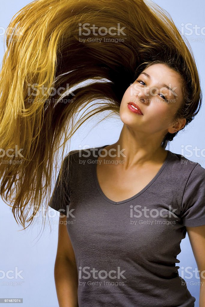 Active beautiful woman with long moving hair royalty-free stock photo