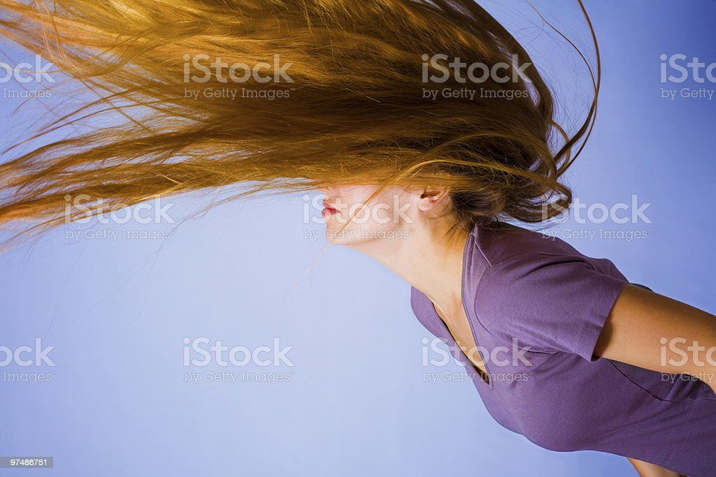 Active blond woman with long hair in motion royalty-free stock photo