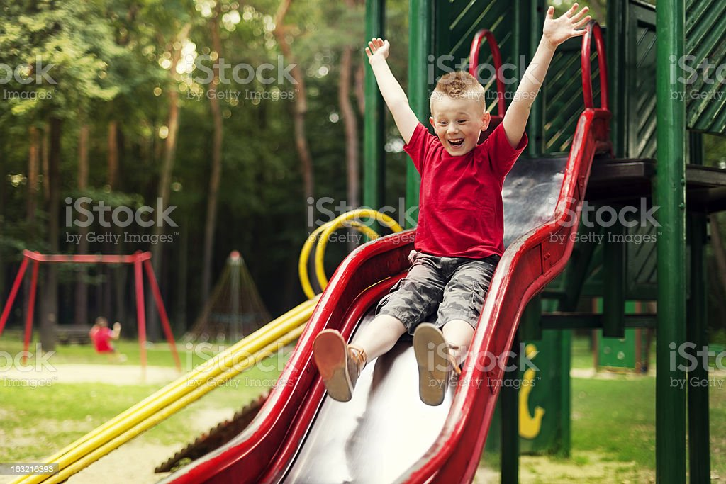 Active boy sliding down royalty-free stock photo