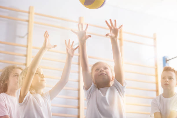 Active children playing volleyball stock photo