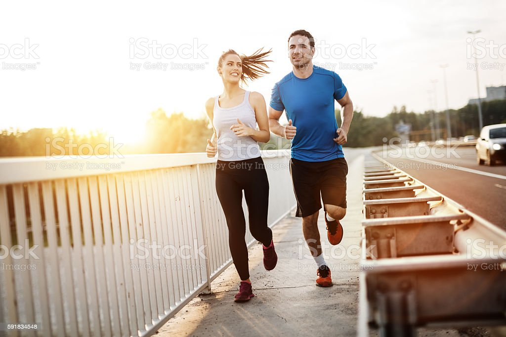 Active couple jogging stock photo