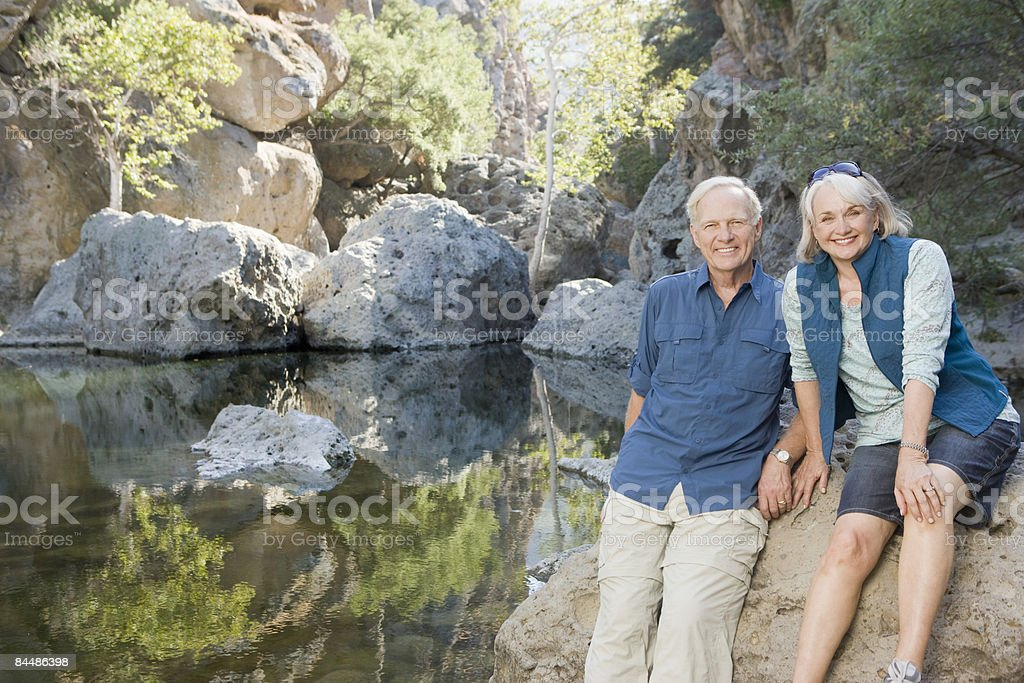 Active couple next to pond royalty-free stock photo