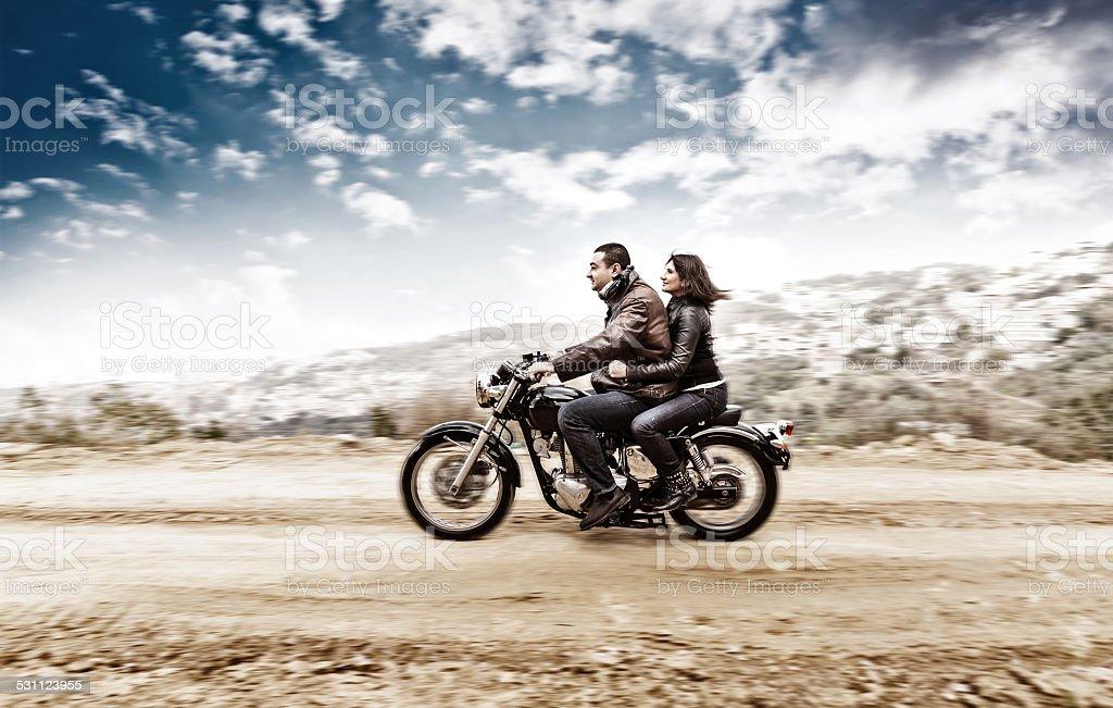 Active couple on the motobike stock photo