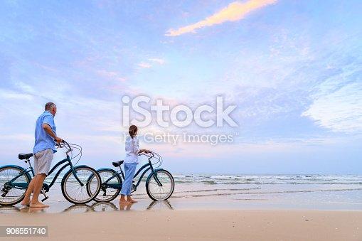 istock Active couple with bikes 906551740