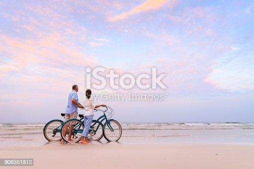 istock Active couple with bikes 906551812