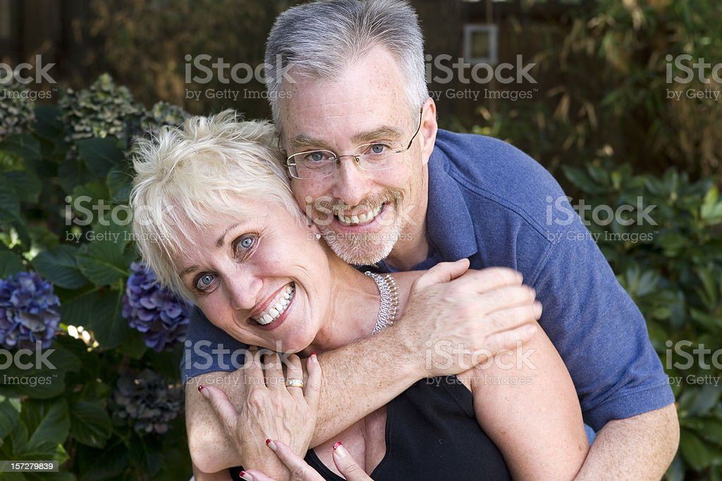 Active Dating Senior Couple Embracing Outside royalty-free stock photo