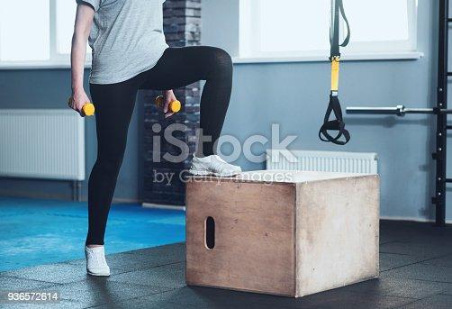 936573360istockphoto Active elderly woman training with dumbbells 936572614