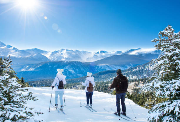 Active family skiing on winter vacation in Colorado. stock photo