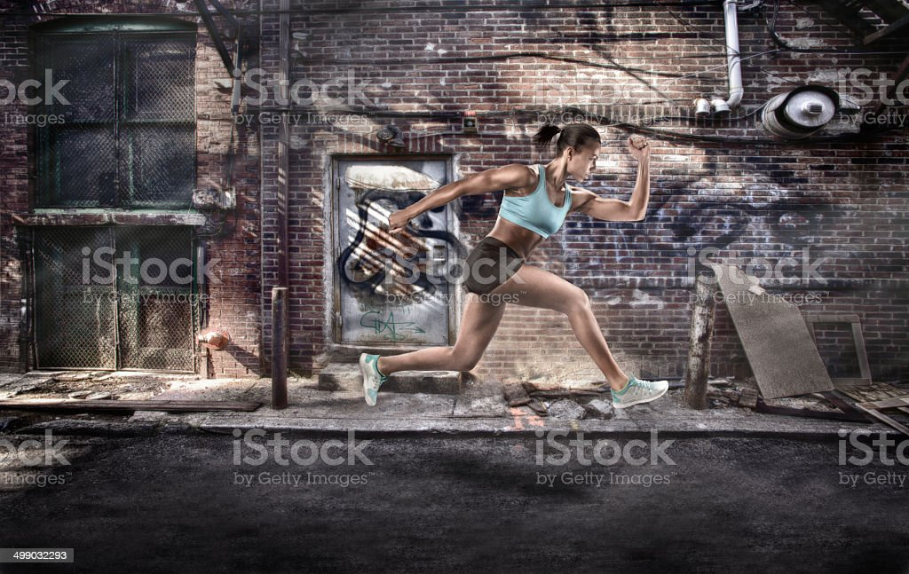 Active Female Jumping in Mid-Air stock photo